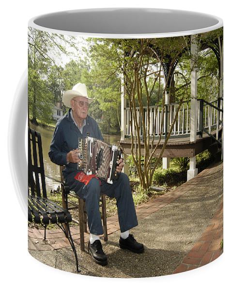 Accordion Coffee Mug featuring the photograph Cajun Man And Accordion by Robert Ponzoni