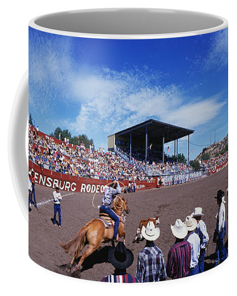 Photography Coffee Mug featuring the photograph Calf Roping Event At Ellensburg Rodeo by Panoramic Images