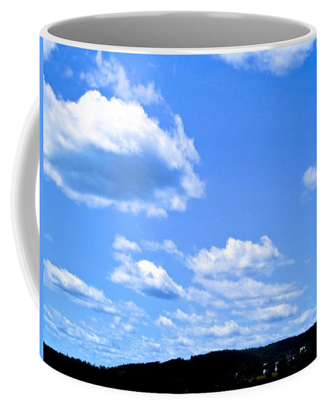 Clouds Coffee Mug featuring the photograph Can I Hitch A Ride? by Mario MJ Perron
