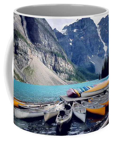 Canoes Coffee Mug featuring the photograph Canoe Rest by Nadia Seme