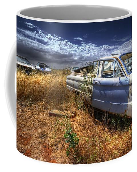 Cars Coffee Mug featuring the photograph Car Graveyard by Wayne Sherriff