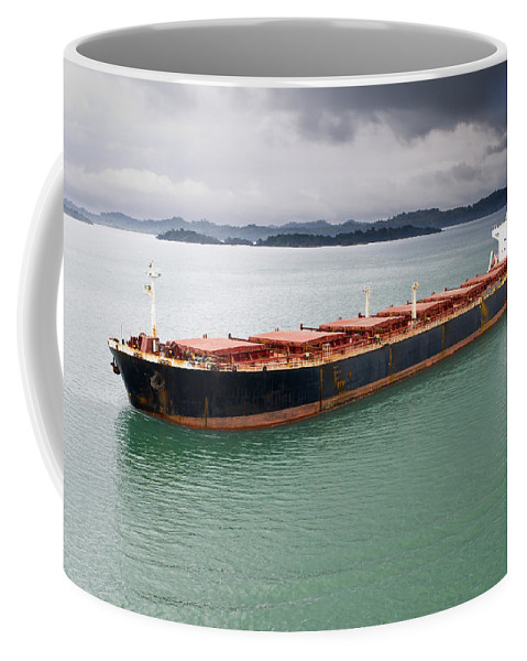 Central America Coffee Mug featuring the photograph Cargo Ship Under Stormy Sky by John Trax