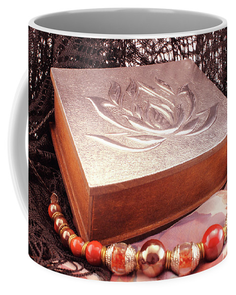 Box Coffee Mug featuring the photograph Carved Box In Aluminum. Silver Box And Red Necklace by Daniel Ghioldi