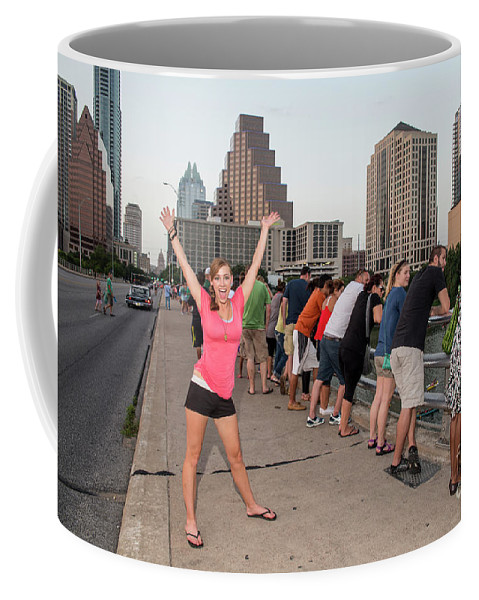 Austin Bats Coffee Mug featuring the photograph Cheerful Attractive Female Austinite Waves Her Hands With Excitement On Seeing The Austin Bats by Austin Bat Tours