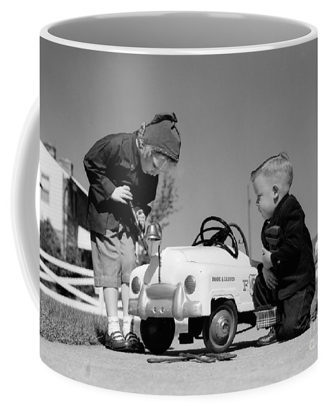 1950s Coffee Mug featuring the photograph Children Play At Repairing Toy Car by H. Armstrong Roberts/ClassicStock
