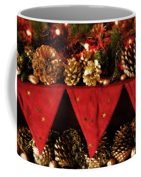 Christmas Coffee Mug featuring the photograph Christmas Decorations Of Garlands And Pine Cones by Mal Bray
