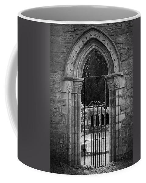 Irish Coffee Mug featuring the photograph Cloister View Cong Abbey Cong Ireland by Teresa Mucha