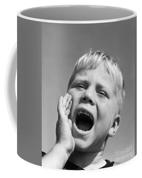 1950s Coffee Mug featuring the photograph Close-up Of Boy Shouting, C.1950s by D. Corson/ClassicStock