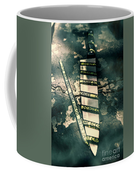 Crime Coffee Mug featuring the photograph Closeup Of Knife Wrapped With Do Not Cross Tape On Floor by Jorgo Photography - Wall Art Gallery