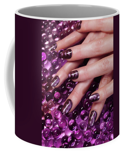 Manicure Coffee Mug featuring the photograph Closeup Of Woman Hands With Purple Nail Polish by Maxim Images Prints