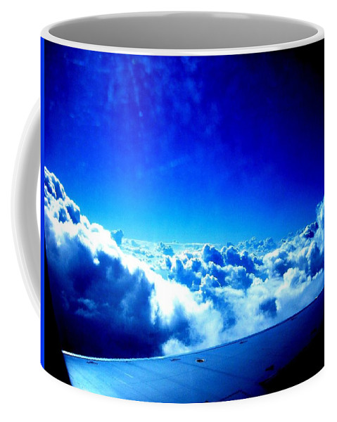 Planes Coffee Mug featuring the photograph Clouds by Michael Grubb