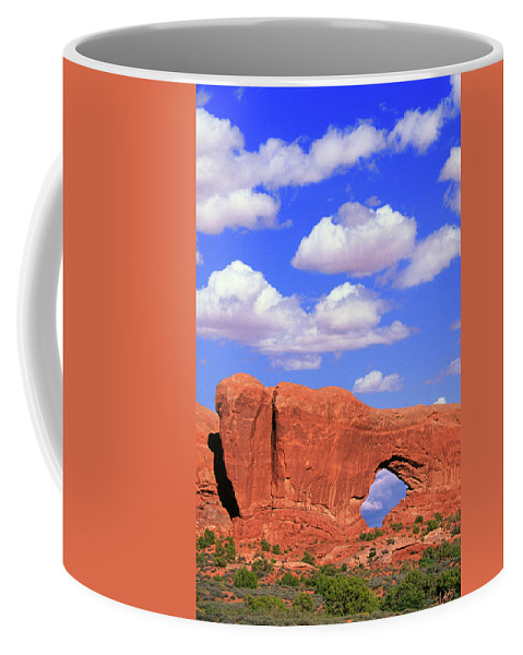 Arches Coffee Mug featuring the photograph Clouds Over The Arches by Buddy Mays