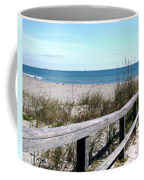 Beach; Florida; Cocoa; Railing; Ocean; Atlantic; Sea; Cocoa Beach; Brevard; Sand; Wood; Ships; Space Coffee Mug featuring the photograph Cocoa Beach In Florida by Allan Hughes