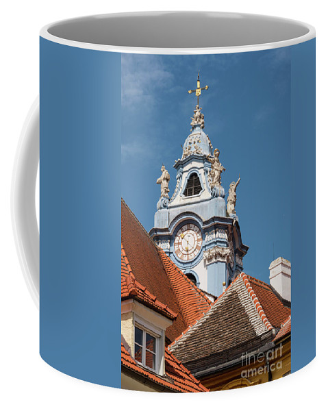 Durnstein Austria Collegeiate Blue Church Tower Building Buildings Structure Structures Architecture Churches City Cities Cityscape Cityscapes Towers Place Of Worship Places Of Worship Red Roof Tiles Tile Cross Crosses Coffee Mug featuring the photograph Collegiate Church Tower by Bob Phillips