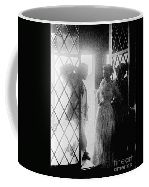 19th Century Coffee Mug featuring the photograph Couple In Doorway by Granger