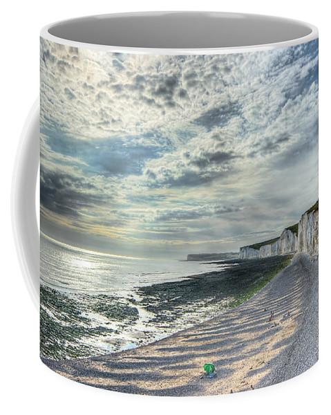 Beach Coffee Mug featuring the photograph Curling Cliffs by Ann Garrett