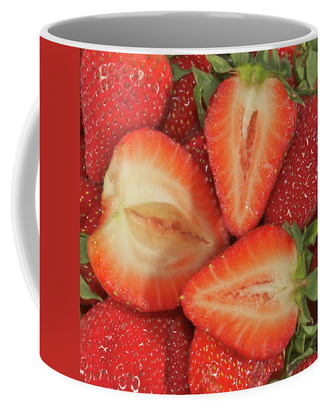 Fruit Coffee Mug featuring the photograph Cut Strawberries by Michael Peychich