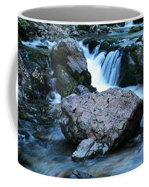 Water Coffee Mug featuring the photograph Deep Creek Flowing Between The Rocks by Jeff Swan