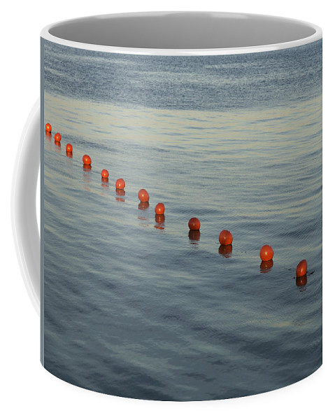 Abstract Coffee Mug featuring the photograph Denmark Red Safety Balls Floating by Keenpress