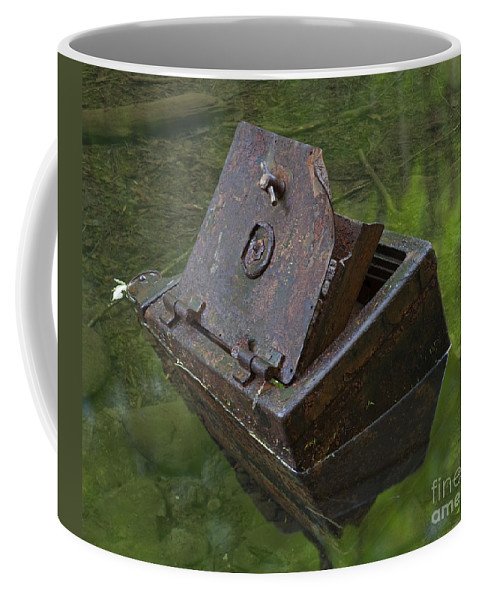 Safe Coffee Mug featuring the photograph Discarded Treasure by John Stephens