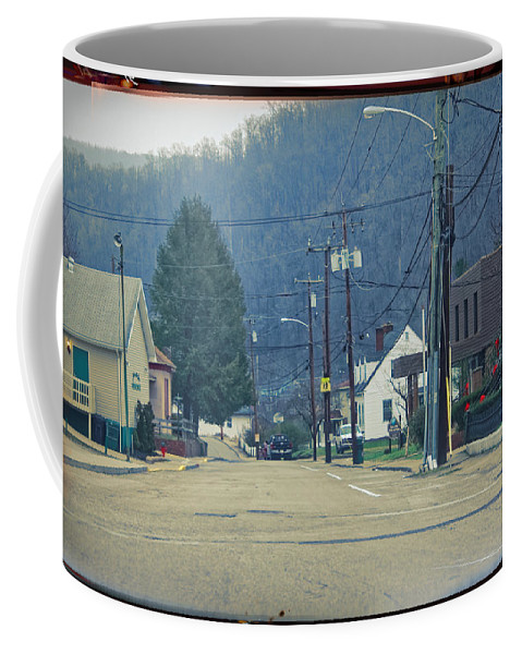 Justified Coffee Mug featuring the photograph Downtown Harlan by Lars Lentz