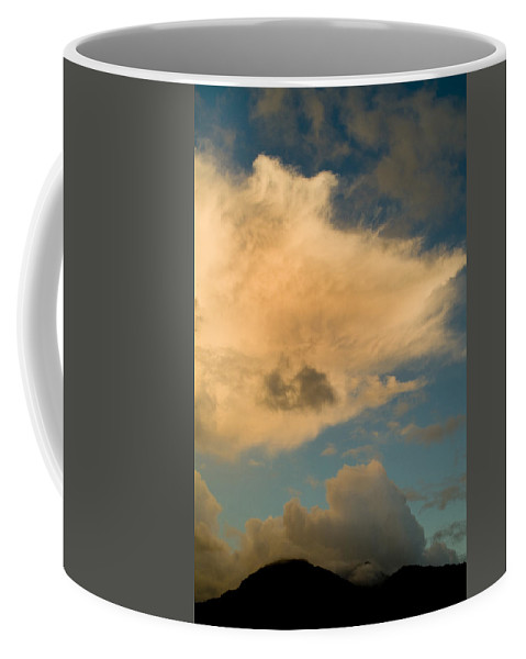 Roseau Coffee Mug featuring the photograph Dramatic Clouds In The Sky Resting by Todd Gipstein