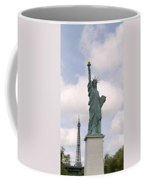 Eiffel Tower Coffee Mug featuring the photograph Eiffel And Liberty by Robert Ponzoni