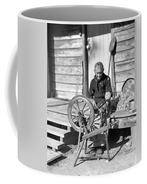 1920s Coffee Mug featuring the photograph Elderly Woman Spinning Wool, C.1920s by H. Armstrong Roberts/ClassicStock