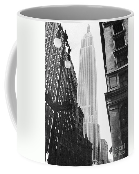 1931 Coffee Mug featuring the photograph Empire State Building, 1931 by Granger