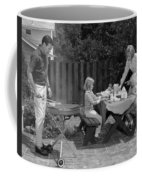 1960s Coffee Mug featuring the photograph Family Bbq, C.1960s by H. Armstrong Roberts/ClassicStock