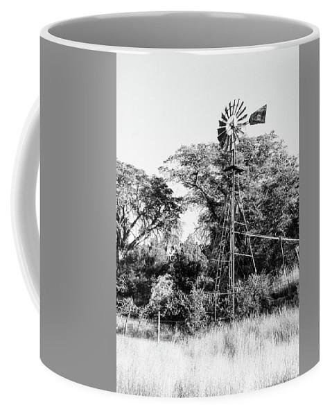 B&w Coffee Mug featuring the photograph Faraway Windmill by Jack Sassard