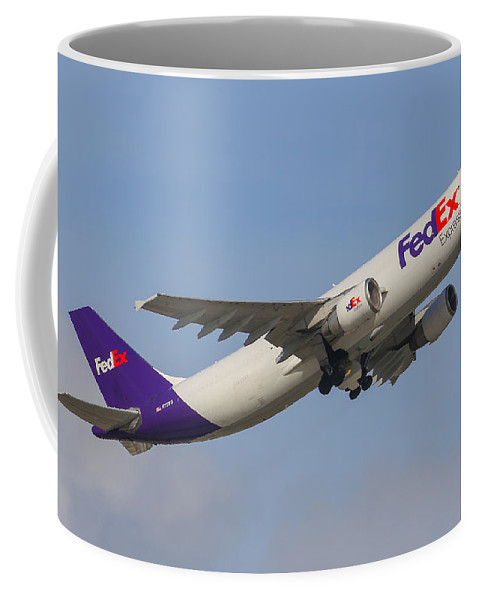Aviation Coffee Mug featuring the photograph FedEx Airplane by Dart and Suze Humeston