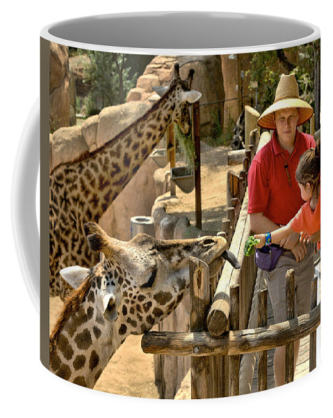 Santa Coffee Mug featuring the photograph Feeding Giraffe 3a by Michael Gordon