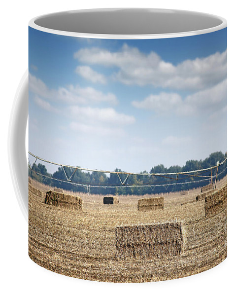 Agricultural Coffee Mug featuring the photograph Field With Straw Bale And Center Pivot Sprinkler System Agricult by Goce Risteski