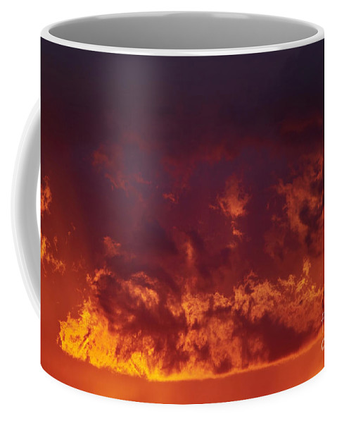 Sunset Coffee Mug featuring the photograph Fiery Clouds by Michal Boubin