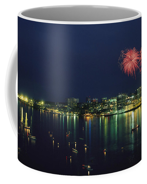 North America Coffee Mug featuring the photograph Fireworks Over Halifax Harbor Celebrate by James P. Blair