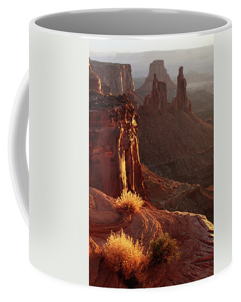 Canyonlands National Park Coffee Mug featuring the photograph First Rays by Marie Leslie
