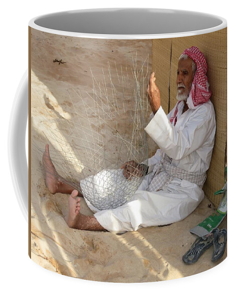 Uae Coffee Mug featuring the photograph Fish Trap Craftsman by Mark Sellers