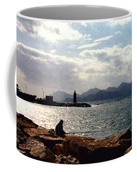 Fisherman Coffee Mug featuring the photograph Fisherman In Nice France by Nancy Mueller