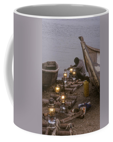 Uganda Coffee Mug featuring the photograph Fisherman Prepares Lanterns For Night by Michael S. Lewis