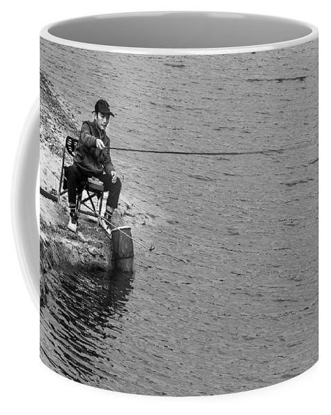 Fishing Coffee Mug featuring the photograph Fisherman's Tail by Lauren Bucke