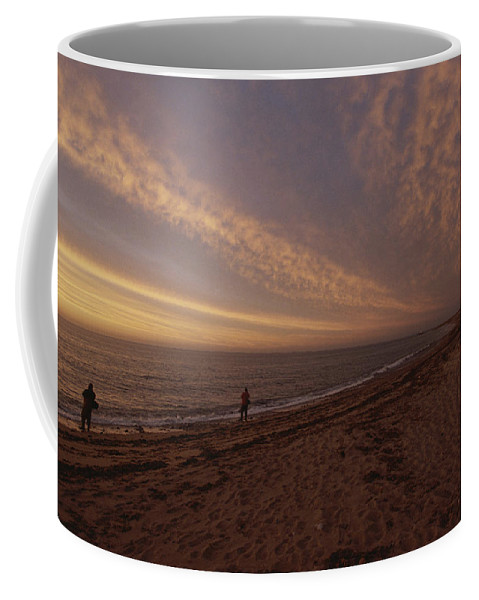Fishing And Fishermen Coffee Mug featuring the photograph Fishermen Fishing In The Surf At Sunset by Todd Gipstein