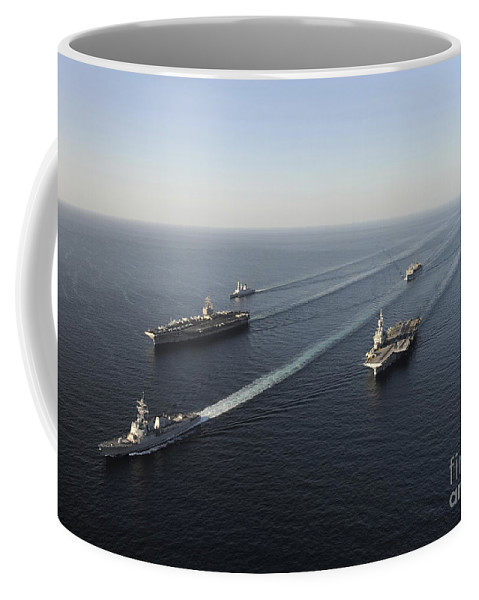 Arleigh Burke Class Coffee Mug featuring the photograph Fleet Of Navy Ships Transit The Arabian by Stocktrek Images