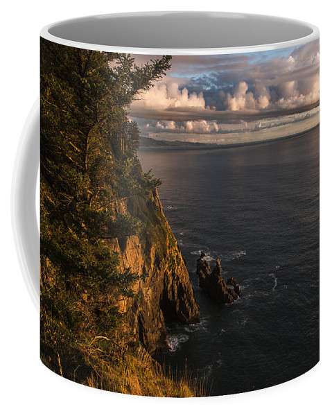 Cliffs Coffee Mug featuring the photograph Floating Clouds by Robert Potts