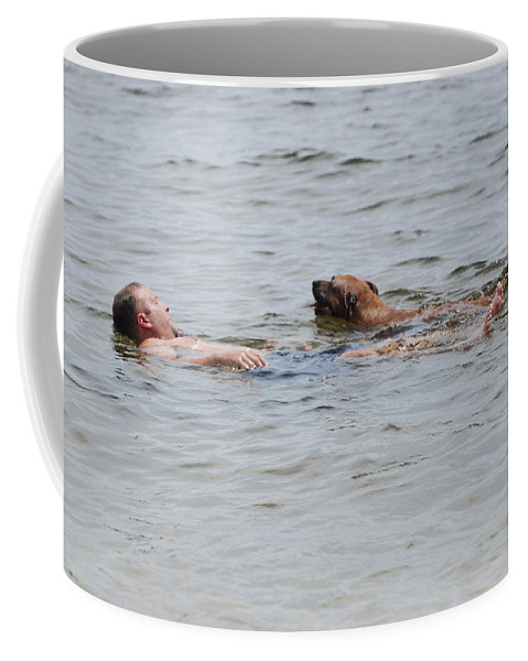 Man Coffee Mug featuring the photograph Floating In The Sea by Rob Hans