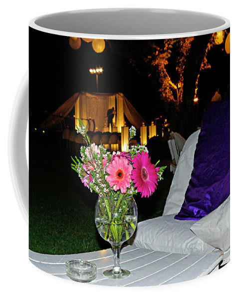 Flowers Coffee Mug featuring the photograph Flowers In A Vase On A White Table by Zal Latzkovich