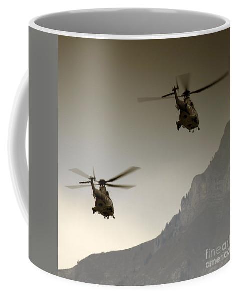 Puma Coffee Mug featuring the photograph Flyaway by Angel Ciesniarska