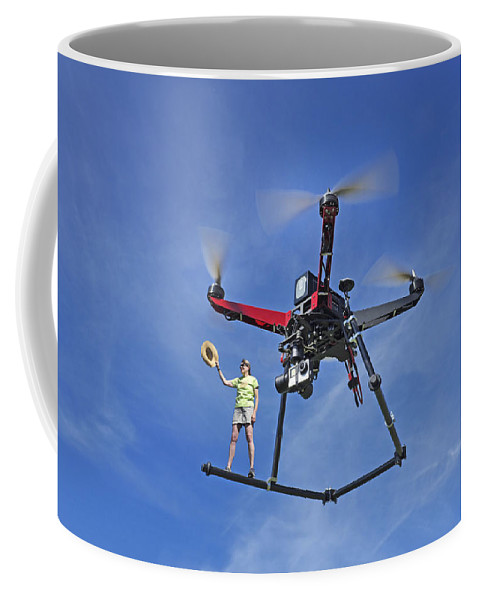 Drone Coffee Mug featuring the photograph Flying A Drone by Buddy Mays