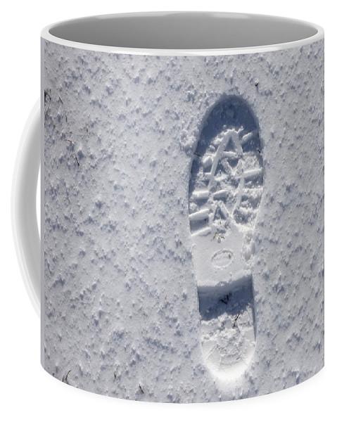 Snow Coffee Mug featuring the photograph Footprint In Snow by Miroslav Nemecek