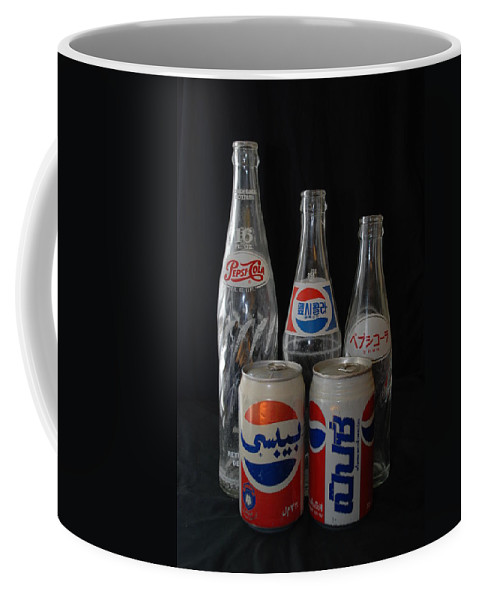 Arabic Coffee Mug featuring the photograph Foriegn Colas by Rob Hans